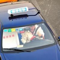 Правила как ловить такси в Пекине. Фото: Борис ван Хойтем.